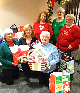 Wish List Gifts for Girls Town presented by Ste. Genevieve Woman's Club officers. Back row:  President-Elect Jackie Korczak, Vice President Gloria Means, and President Sue Koch.  Front row:  (Receiving the gifts - Kathy Becker, Executive Director of Missouri Girls Town), Corresponding Secretary Diane Miller and Recording Secretary Shirley Gray